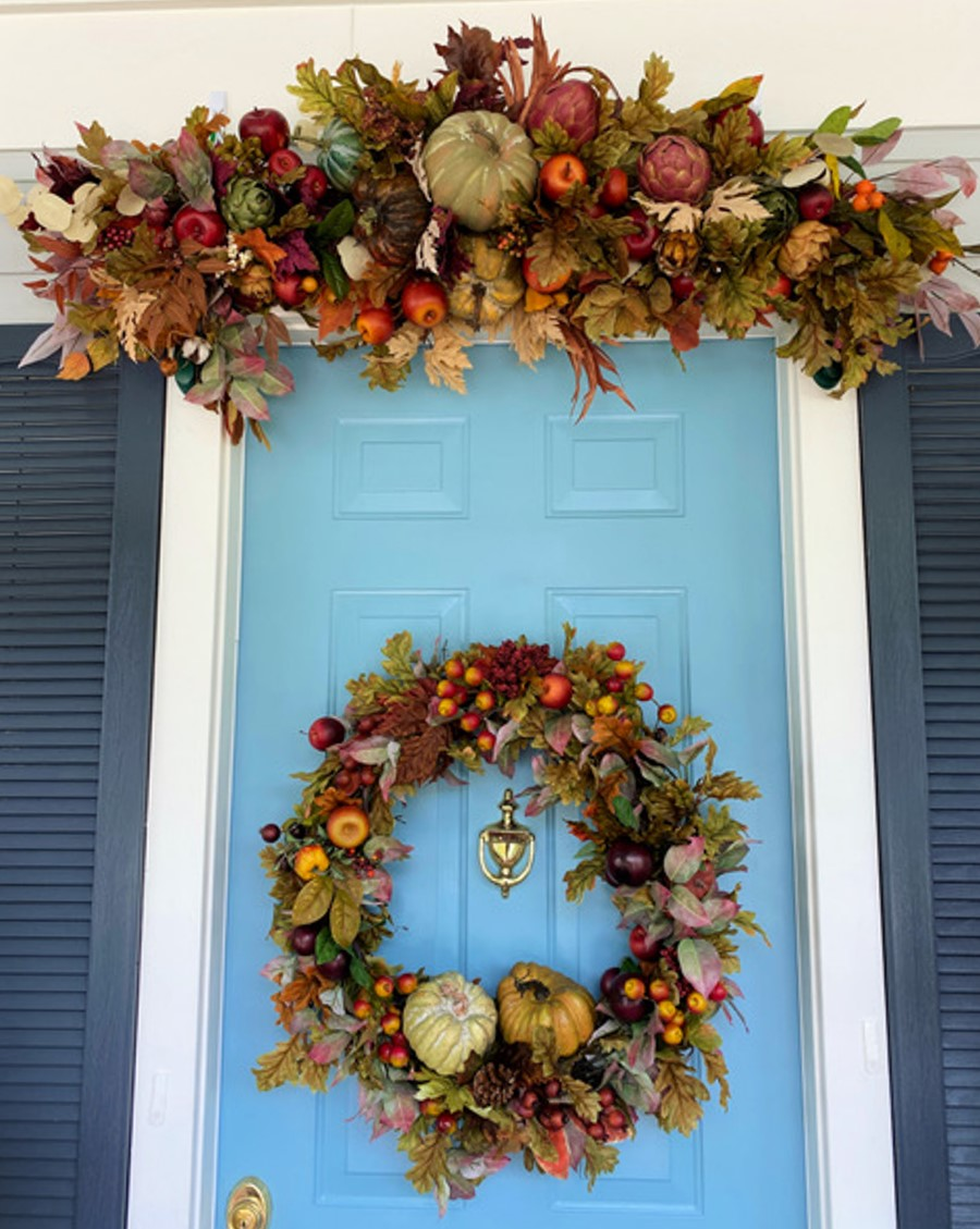 Blue door decorated for fall.